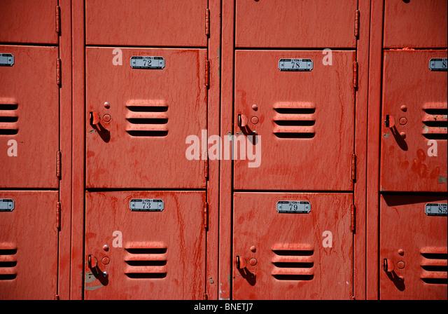Red metal lockers at the public pool in Moab, Utah - Stock Image