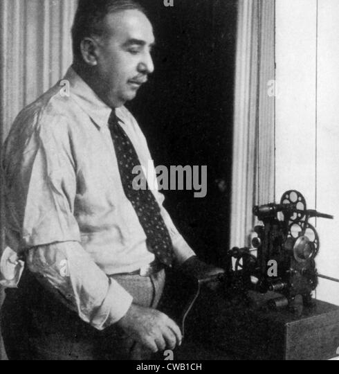 Edwin S. Porter (1869-1941) with an early model of the Edengraph movie projector - Stock Image