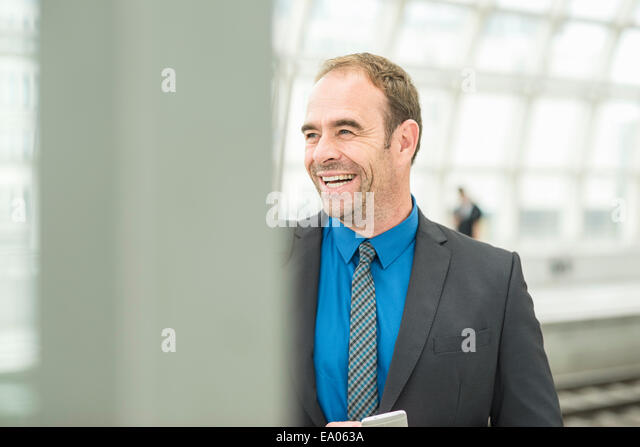 Businessman laughing - Stock Image