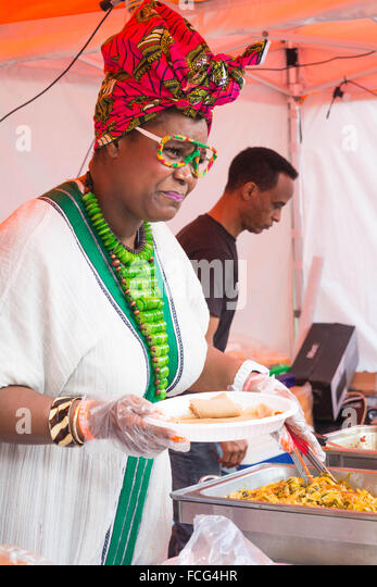 Woman serving food - Stock-Bilder