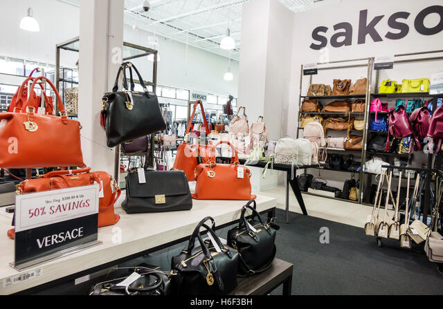 Palm Beach Florida Outlets shopping Saks Fifth Avenue Off 5th inside display sale Versace designer handbags - Stock Image