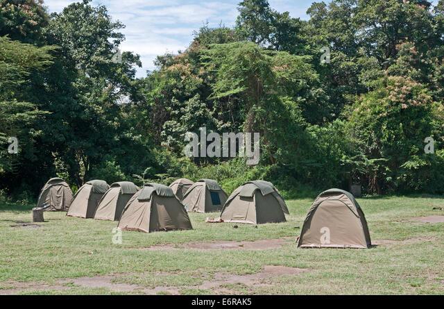Tents on camp site near Makalia Falls in Lake Nakuru National Park Kenya East Africa  CAMPS SITE TENT TENTS LAKE - Stock Image