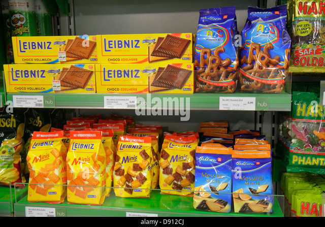 Germany Frankfurt am Main Airport FRA terminal gate area concourse shopping retail display for sale German language - Stock Image