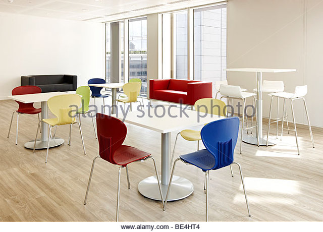 Office canteen bright colored seating - Stock Image