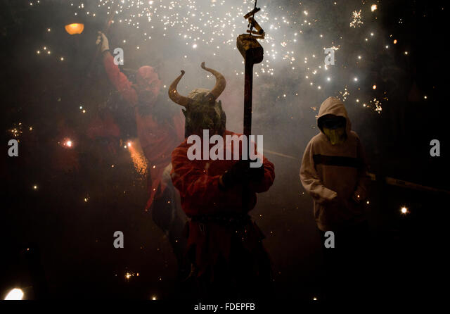 Barcelona, Spain, 30th January, 2016.A devil burns gunpowder during the festival of Els Foguerons in Barcelona, - Stock Image