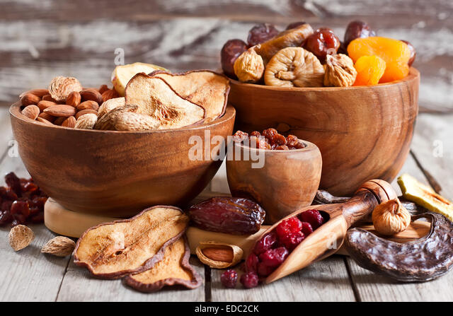 Mix of dried fruits and almonds - symbols of judaic holiday Tu Bishvat. - Stock Image