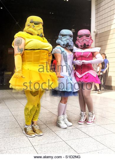 Three female cosplayers dressed as colourful storm troopers with glittery helmets, at Star Wars Celebration Europe, - Stock-Bilder