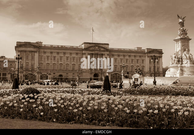 A Landscape view of Buckingham Palace in the Spring time with an antique sepia tone look City of Westminster London - Stock Image