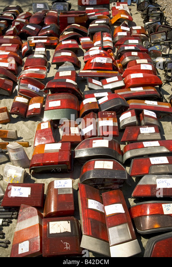 a series of labelled second hand rear brake lights from an assortment of cars at a 'car boot' sale - Stock Image