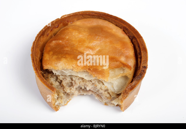 Scotch pie, a small double-crust meat pie filled with minced mutton or other meats, traditionally eaten at football - Stock Image