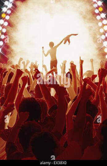 Audience enjoying live concert - Stock Image
