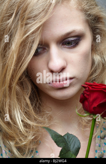 Woman with a rose - Stock Image