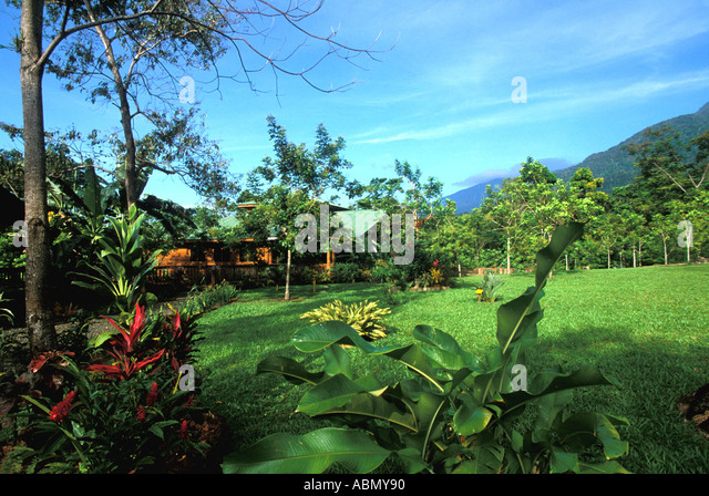 Lodge at Pico Bonito La Cieba Honduras Central America Garden buildings horizontal early morning - Stock Image