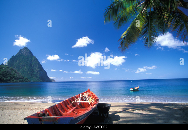 St Lucia beach saint lucia Fishing Boat at Soufriere with Petit Piton in Background - Stock Image