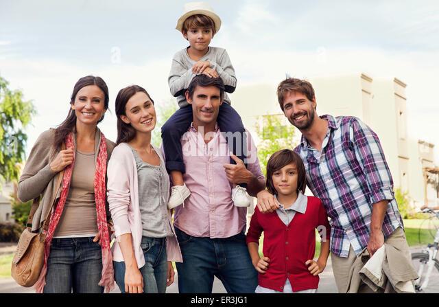 Family posing for group portrait outdoors - Stock-Bilder