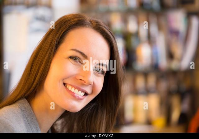 beautiful female coffee bar smiling - Stock Image