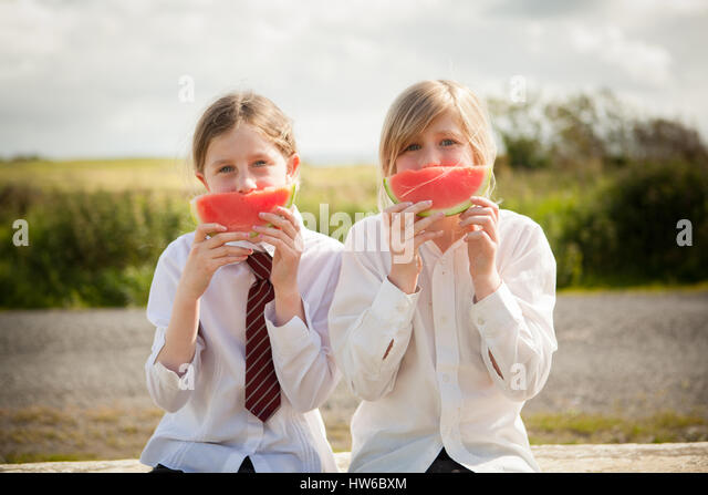 Girls eating watermelon - Stock Image