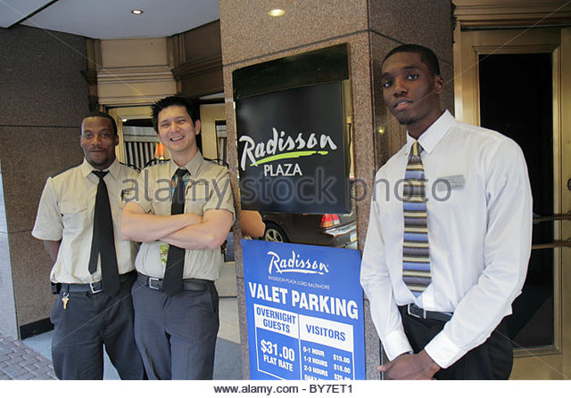 Baltimore Maryland Radisson Plaza Lord Baltimore Hotel global company business lodging Black man job employee parking - Stock Image