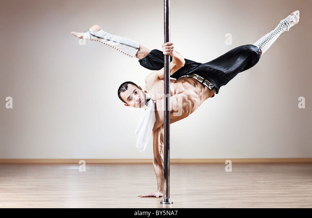 Young strong pole dance man. - Stock Image