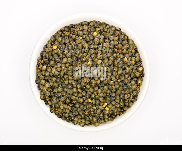Puy Lentils in a white bowl - Stock Image