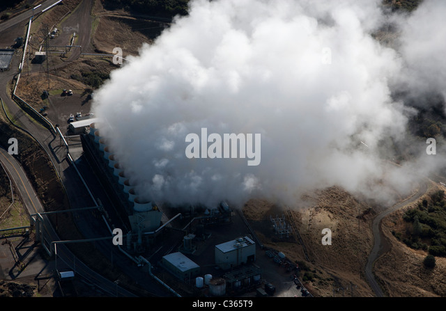 aerial above The Geysers largest group of geothermal power plants in the world northern California - Stock Image