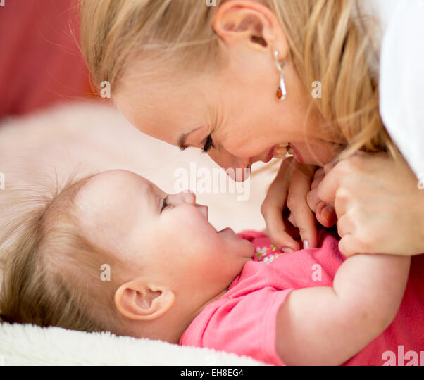 Mom looks with love at child. Parenthood happiness conception. - Stock Image
