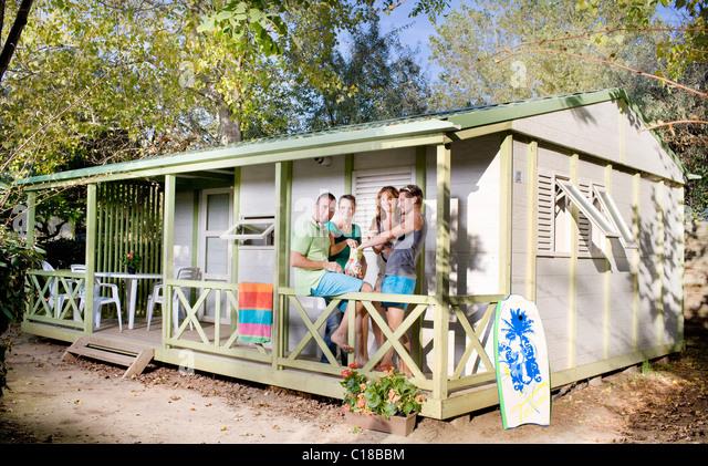 Group eat snacks on terrace cabin - Stock-Bilder