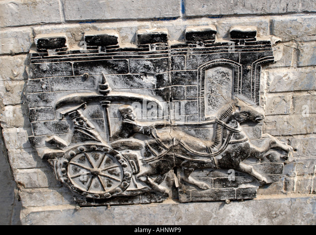 Chinese Chariot carving on wall in hutong of Beijing, China - Stock Image