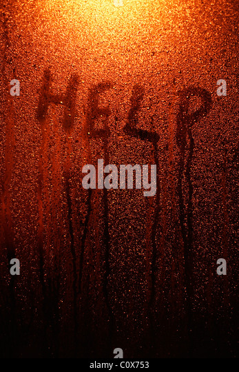 Help - finger tip writing on window with condensation. - Stock Image