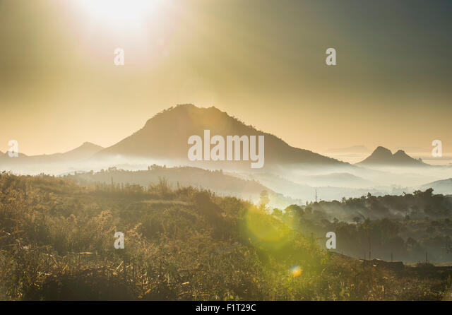 Sunrise and fog over the mountains surrounding Blantyre, Malawi, Africa - Stock Image