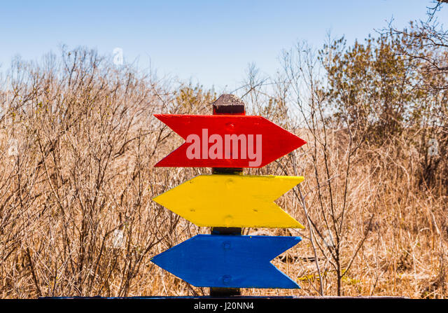 Blank signs shaped like arrow in primary colors - Stock Image
