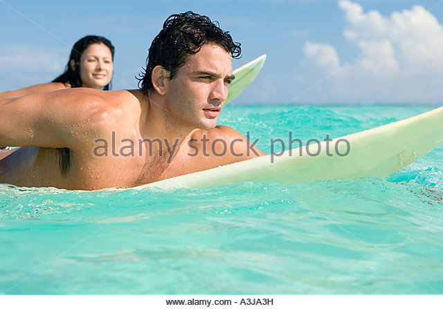 Man and woman surfing - Stock Image