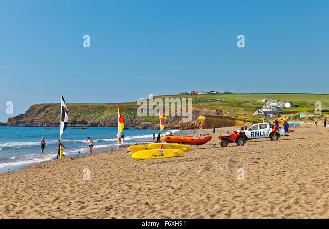 RNLI Lifeguards on the beach at Widemouth Bay making sure that surfers and swimmers are safe, Cornwall, England, - Stock Image