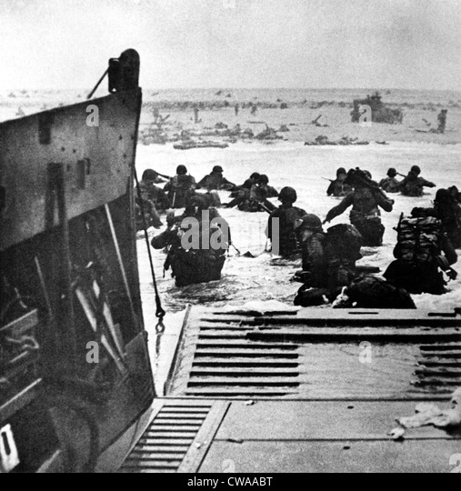 World War II: Led by amphibious tanks, British troops assault a beach.. Courtesy: CSU Archives / Everett Collection - Stock Image