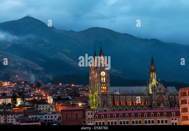 Night time view of the basilica and old town in Quito, Ecuador - Stock Image