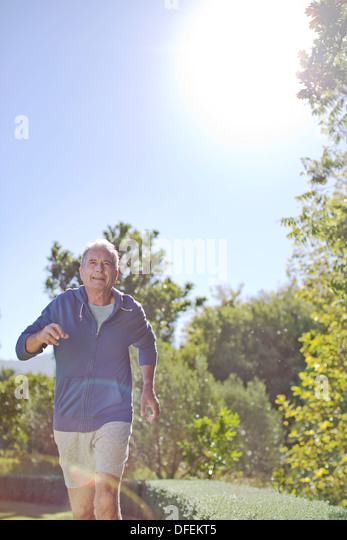 Senior man running in park - Stock Image