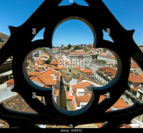 Outlook through a wrought iron grid of Santa Justa Elevator, Elevador de Santa Justa or Elevador do Carmo, over - Stock Image