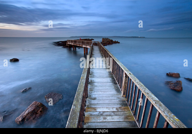 Jetty at Pans Rocks on Antrim coast. Northern Ireland. - Stock Image