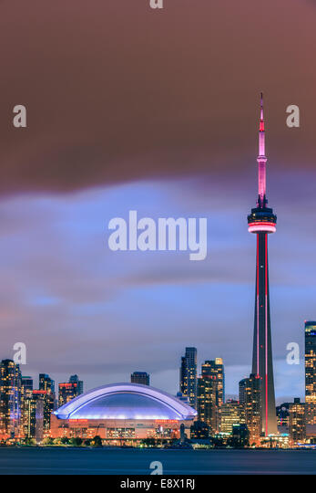Famous Toronto Skyline with the CN Tower and Rogers Centre after sunset taken from the Toronto Islands. - Stock Image