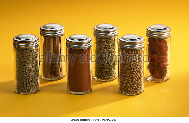 Assorted spices in jars - Stock Image