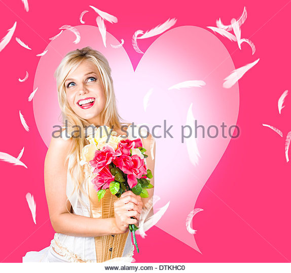 Female beauty in the fall of a soft romance - Stock Image