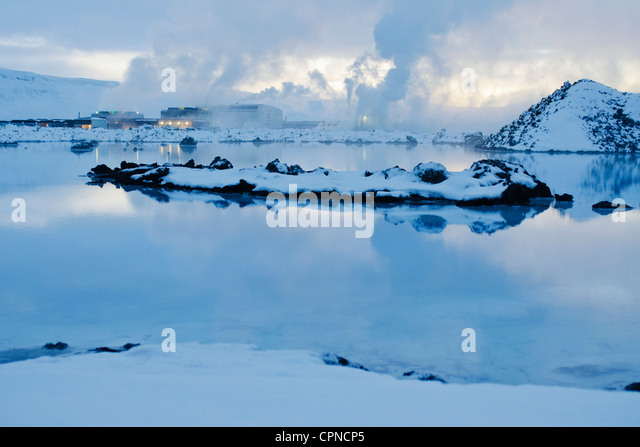Iceland, Reykjanes Peninsula, Blue Lagoon geothermal spa, geothermal power plant in background - Stock Image