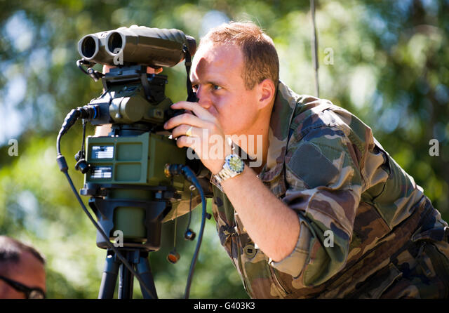 French Army Sergeant watches the impact zone at Camp Atterbury. - Stock Image