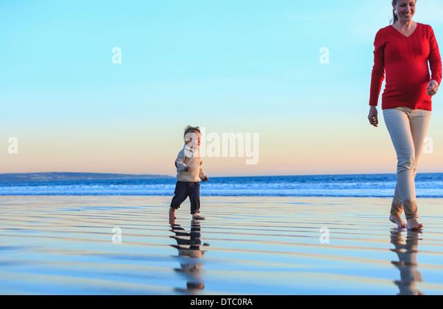 Mother and toddler son having fun on beach, San Diego, California, USA - Stock Image