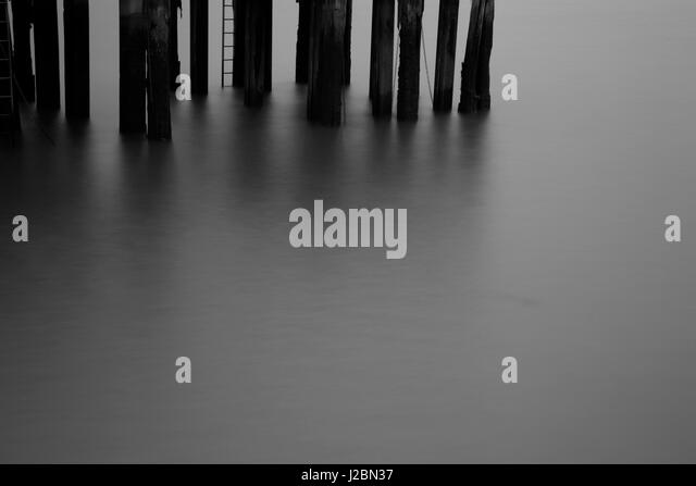 Old jetty on the River Thames at Fulham Reach, Fulham, London, UK - Stock Image