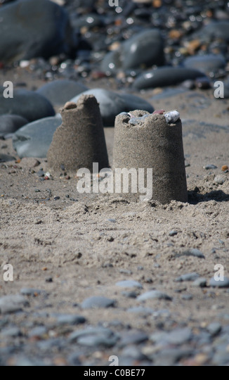 Twon sand castles on the beach - Stock Image