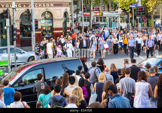 Melbourne Australia Victoria Central Business District CBD Flinders Street pedestrians pedestrian crossing traffic - Stock Image