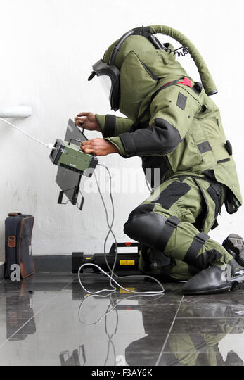 Member of bomb squad assigned to defuse explosive devices in simulated security in the East Parking Senayan, Jakarta. - Stock Image