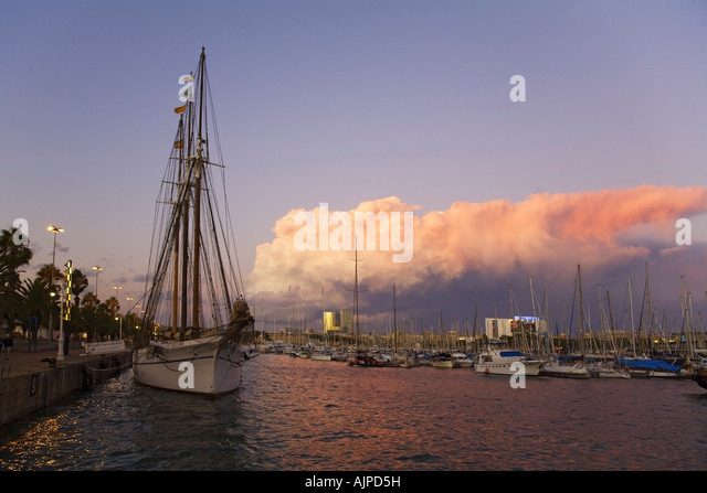 Barcelona Port Vell sunset Santa Eulalia sailing boat, - Stock Image