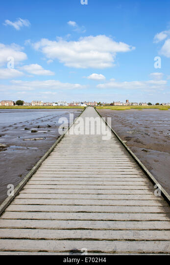 View from the end of the jetty in Lytham, Lancashire, back towards the town (tide out) - Stock Image